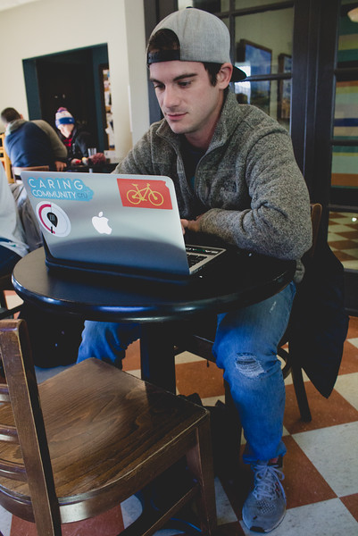 Stephen Karst, a Cru missionary staff member sits on his laptop at Bluestem Bistro in Aggieville. (Andrea Klepper | Collegian Media Group)