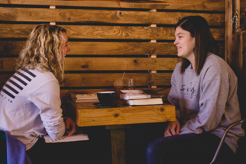 Lauren Harbseter, sophomore in life sciences (left) and Staci Gann, recent K-State graduate (right) hangout at Sparrow Specialty Coffee. (Andrea Klepper | Collegian Media Group)