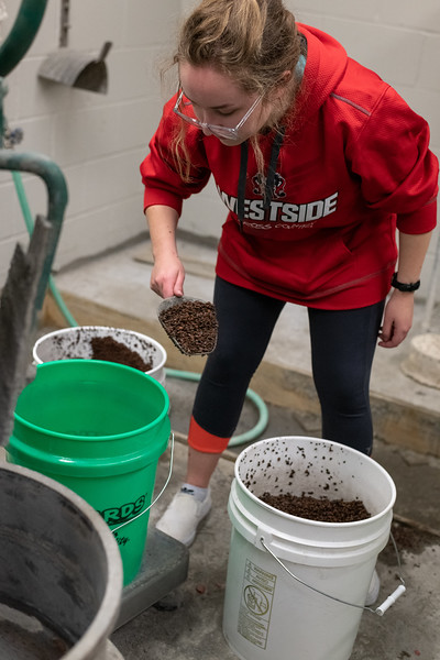 K-State freshman in Civil Engineering, Madeline Akers, measures out ingredients for a fresh mix of concrete on November 1, 2018. (Alex Todd | Collegian Media Group)