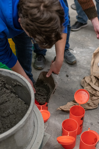 Junior in Civil Engineering Zane Beattie puts a fresh mix of concrete into a cylinder mold during a concrete canoe team meeting on November 1, 2018. (Alex Todd | Collegian Media Group)