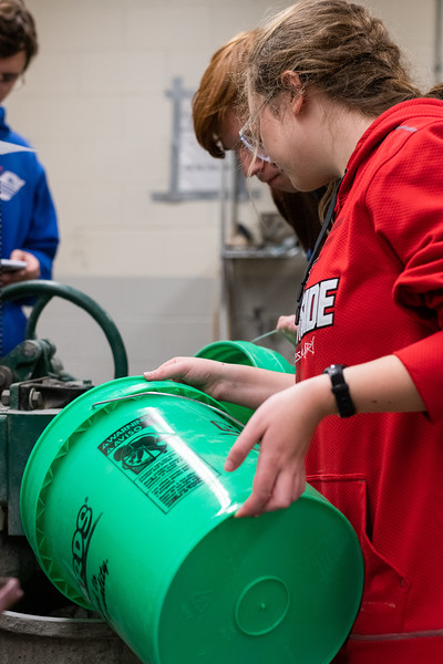 Madeline Akers and Ian Mosier pour water and cement together to create a concrete mix during a team meeting on November 1, 2018. (Alex Todd   Collegian Media Group)
