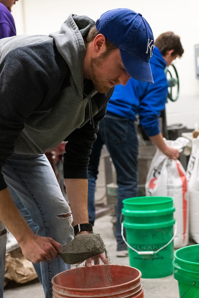 Concrete canoe co-captain Jared Fangman measures out cement for a fresh mix of concrete during a team meeting on November 1, 2018. (Alex Todd | Collegian Media Group)