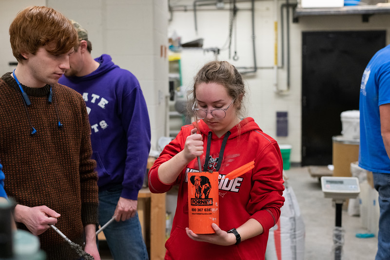 Freshman in Civil Engineering Madeline Akers puts a fresh mix of concrete into a cylinder mold during a concrete canoe team meeting on November 1, 2018. (Alex Todd | Collegian Media Group)