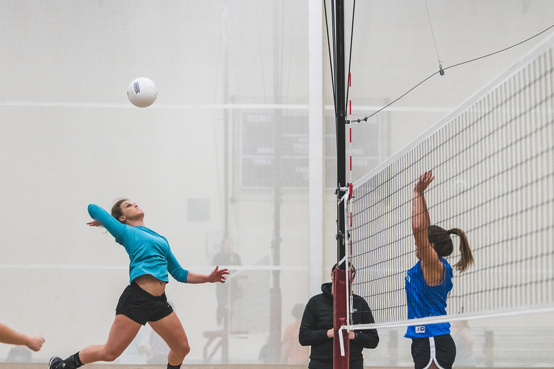 A member of the Alpha Xi Delta volleyball team jumps upward to launch the ball over the net during an intramural volleyball game at the rec on November 6, 2018. (Alex Todd | Collegian Media Group)