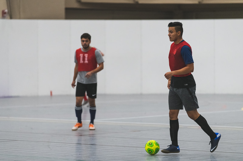 Watching the opposing teams defense, K-State junior Anthony Lopez runs down the court with the ball during an intramural soccer match at the rec on November 7, 2018. (Alex Todd | Collegian Media Group)