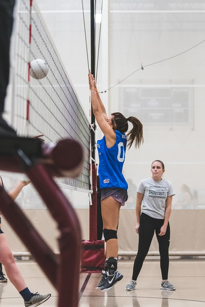 """Leaping up to block the ball, a member of the """"Dirty Diggers"""" doesn't let the Alpha Xi Delta team score during an intramural volleyball game on November 6, 2018. (Alex Todd 