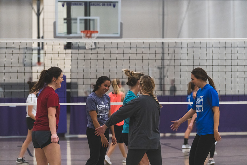 """The """"Dirty Diggers"""" celebrate after scoring a kill during an intramural volleyball game at the rec on November 6, 2018. (Alex Todd 