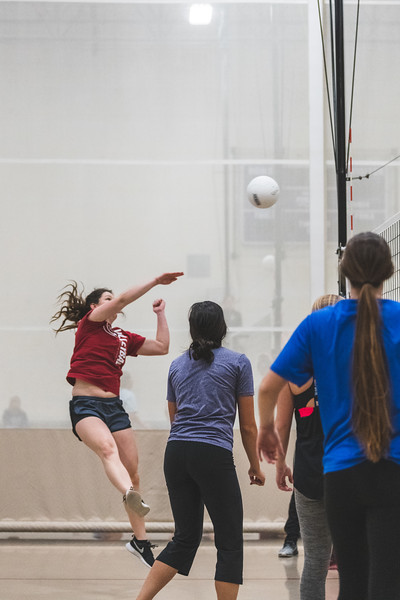 After a successful set by a team member, the Dirty Diggers spike the ball over to score a kill against Alpha Xi Delta during an intramural volleyball game at the rec on November 6, 2018. (Alex Todd | Collegian Media Group)