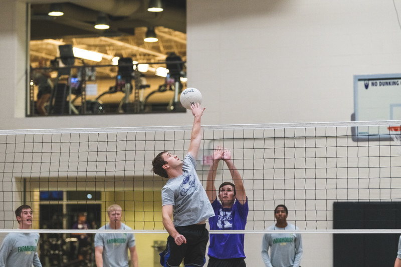 Leaping to hit the ball over the net, a K-State student successfully gets a kill during an intramural volleyball game at the rec on November 6, 2018. (Alex Todd | Collegian Media Group)