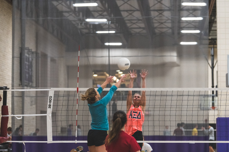 Leaping up to block the ball, a member of the Alpha Xi Delta volleyball team prevents a kill by the Dirty Diggers during an intramural volleyball game at the rec on November 6, 2018. (Alex Todd | Collegian Media Group)