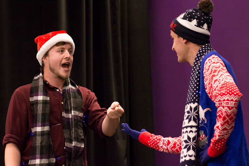 Brennan Flanagan (left) pretends to hold out a sticky spatula to Jacob Casey (right) during a skit for the Halloween Show on October 29, 2018 in Wildcat Chamber. On the Spot Improv holds weekly performances on campus throughout the school year. (Andrea Klepper | Collegian Media Group)