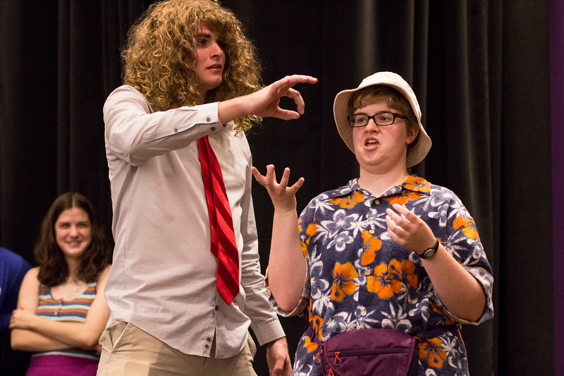 Nate Kochuyt (left) pretends to hand a nail to Lorna Hurt (right) during a skit for the Halloween Show on October 29, 2018 in Wildcat Chamber. On the Spot Improv holds weekly performances on campus throughout the school year. (Andrea Klepper | Collegian Media Group)