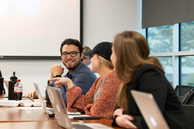 SGA Technology Director Victor Valdez listens as Public Relations Director Meredith Clark shares and update with the group during the SGA cabinet meeting on November 1, 2018. (Alex Todd | Collegian Media Group)