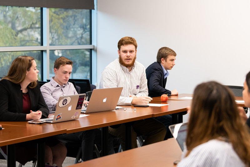 SGA Local Relations Director, Corbin Sedlacek, shares his thoughts on a group discussion during the SGA cabinet meeting on November 1, 2018. (Alex Todd | Collegian Media Group)