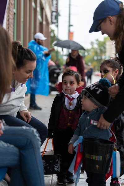 A young vampire waits his turn for halloween candy outside of Rallyhouse in Aggieville on October 12, 2018. (Alex Todd | Collegian Media Group)