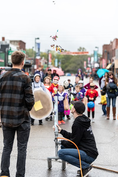 Watching intently, kids wait for candy to be shot out of a candy canon so that they can add it to their collection during the annual Trick or Treat event in Aggieville on October 12, 2018. (Alex Todd | Collegian Media Group)