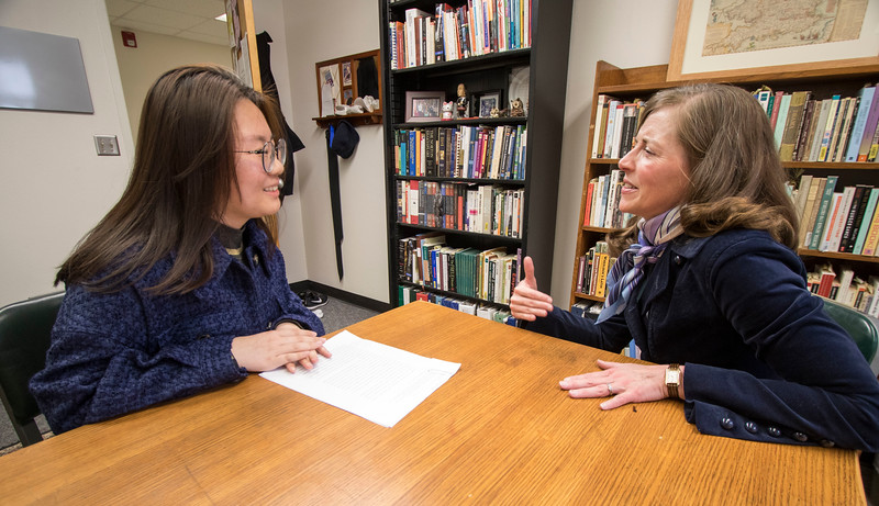 Academic advisor Kara Northway speaks with a Tian Dong, a senior in Education about her recent essay and ways in which she can improve in the class. (Sabrina Cline | Collegian Media Group)