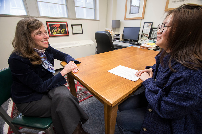 Academic advisor Kara Northway speaks with Tian Dong, a senior in Education about her recent essay and ways in which she can improve in the class. (Sabrina Cline | Collegian Media Group)