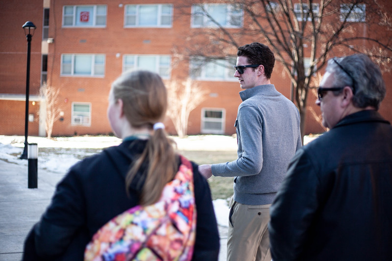 Jacob Bandy, senior transfer in Environmental Design, walks alongside the tour group as they walk by the dorms.<br /> (Alanud Alanazi   Collegian Media Group)