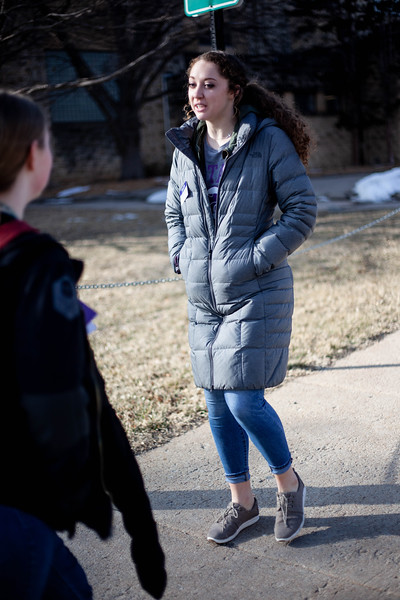 Grace Scoot, sophomore in Social Work, talks to perspective student about the different sporting activities at K-State as she passes Ahern Fieldhouse. <br /> (Alanud Alanazi   Collegian Media Group)