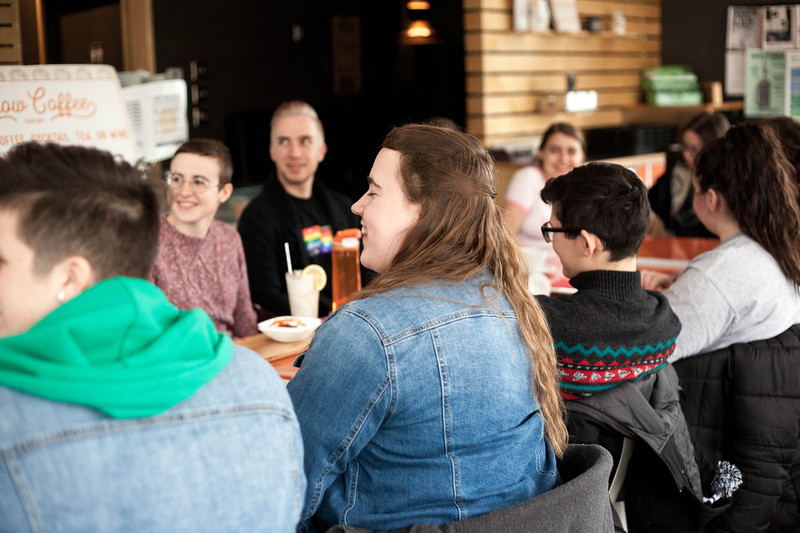 Listening in, members lean in to hear new members introduce themselves during the Nov. 22, 2019 Fiminist Firday meet. <br /> (Alanud Alanazi | Collegian Media Group)