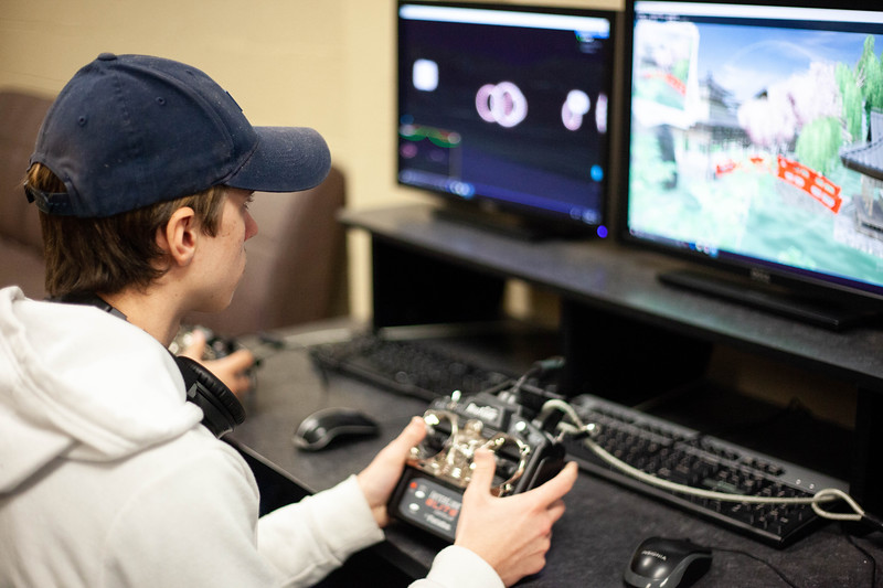 Julian Naber practices with the drone simulter, preparing to affectivly use his skill to fly a drone for the class. Drones are offered to students during the Drone Photography and Video class offered in the AQ Miller School of Journalism. <br /> (Alanud Alanazi | Collegian Media Group)