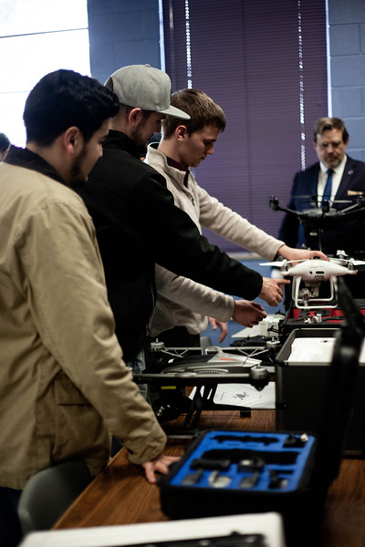 Students reach out and familiarize themselves with the drones. Drones are offered to students during the Drone Photography and Video class offered in the AQ Miller School of Journalism. <br /> (Alanud Alanazi | Collegian Media Group)