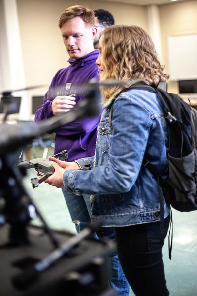 Piper Brandt holds one of the drones desplayed in class. Drones are offered to students during the Drone Photography and Video class offered in the AQ Miller School of Journalism. <br /> (Alanud Alanazi | Collegian Media Group)