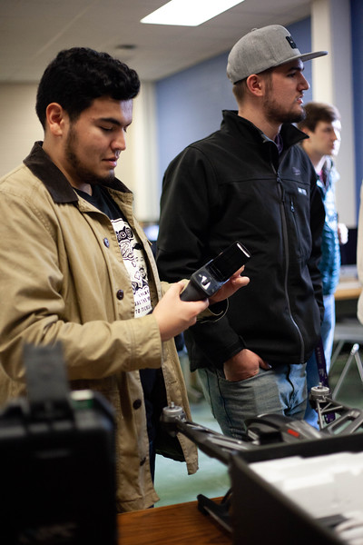 Zach Perez holds one of the remote controllers desplayed in class. Drones are offered to students during the Drone Photography and Video class offered in the AQ Miller School of Journalism. <br /> (Alanud Alanazi | Collegian Media Group)