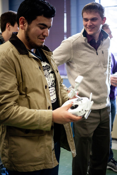 Zach Perez checks out the remote controller for one of the drones on display during class. <br /> (Alanud Alanazi | Collegian Media Group)