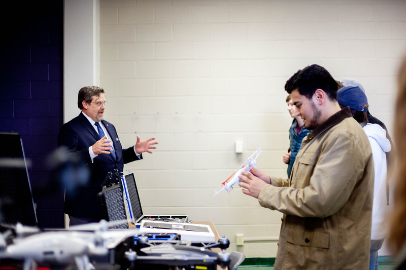 Nick Homburg explains the techncallities of drone operations while Zach Perez holds one of the smaller drones. Drones are offered to students during the Drone Photography and Video class offered in the AQ Miller School of Journalism. <br /> (Alanud Alanazi | Collegian Media Group)