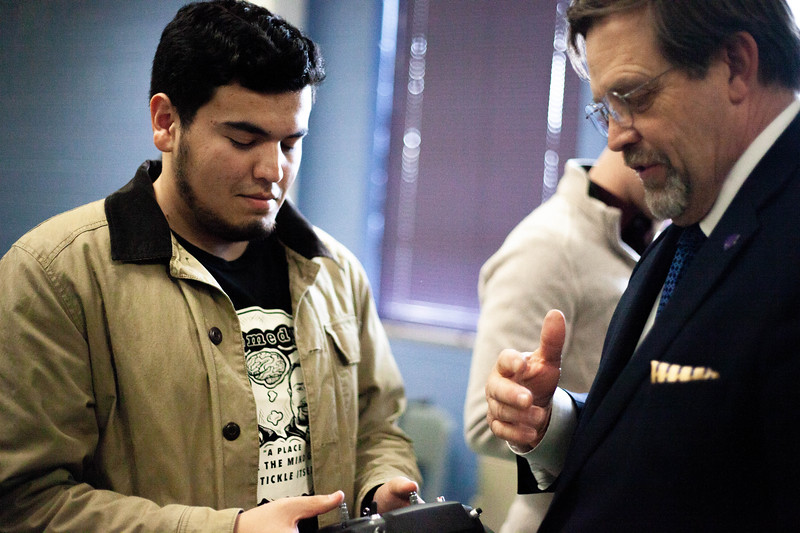 Zach Perez holds a controller while Professor Nick Homburg explains the working of said remote.  Drones are offered to students during the Drone Photography and Video class offered in the AQ Miller School of Journalism. <br /> (Alanud Alanazi | Collegian Media Group)