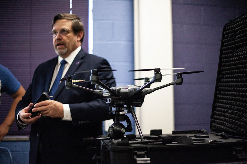 Nick Homeburg introduces a lineup of some of the drones offered to students during the Drone Photography and Video class offered in the AQ Miller School of Journalism. <br /> (Alanud Alanazi | Collegian Media Group)