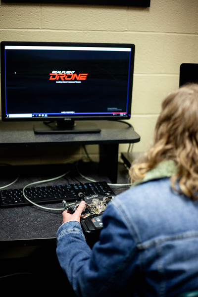 Piper Brandt practices with the drone simulter, preparing to affectivly use her skills to fly a drone for the class. Drones are offered to students during the Drone Photography and Video class offered in the AQ Miller School of Journalism. <br /> (Alanud Alanazi | Collegian Media Group)