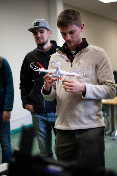 Mesmorized, Kyle Stithem holds one of the drones desplayed in class. Drones are offered to students during the Drone Photography and Video class offered in the AQ Miller School of Journalism. <br /> (Alanud Alanazi | Collegian Media Group)