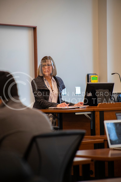 Professor Schmelz stands at the head of her advanced selling business course, while students prepare for a quiz. Students and faculty wear face masks, face shields and are spread out six feet apart in an effort to stop the spread of the COVID-19 virus.  (Dalton Wainscott I Collegian Media Group)