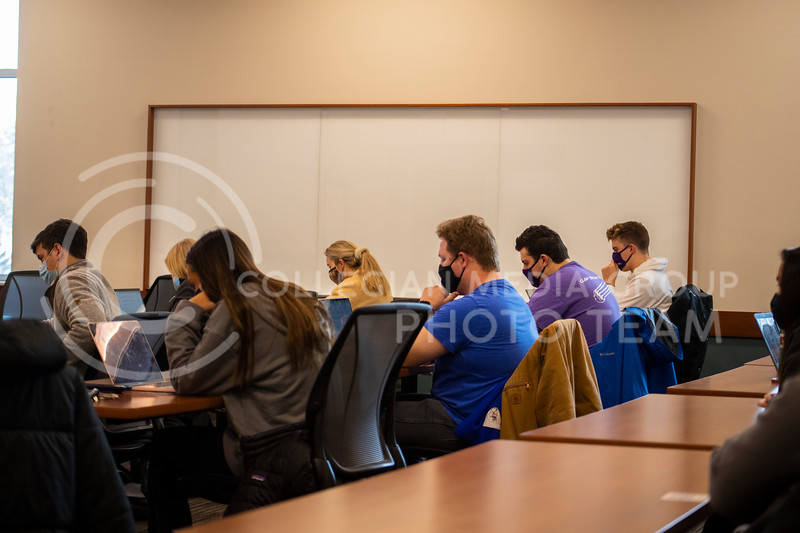 Students take an online test in professor Schmelz advanced selling business course in the business building. Students and faculty wear face masks, face shields and are spread out six feet apart in an effort to stop the spread of the COVID-19 virus.  (Dalton Wainscott I Collegian Media Group)