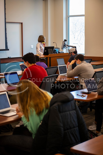 Students take an online test at the beginning of professor Schmelz advanced selling business course. Students and faculty wear face masks, face shields and are spread out six feet apart in an effort to stop the spread of the COVID-19 virus.  (Dalton Wainscott I Collegian Media Group)