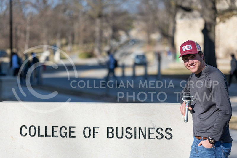 Kansas State Sophomore, Blake Chance, majoring in Agriculture Business with a minor in Entrepreneurship, holds his newly developed pin used to simplify the release of a baler in an emergency. (Dylan Connell | Collegian Media Group)
