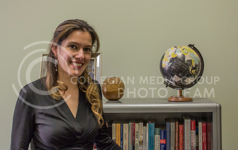 Two Kansas State University political science researchers have been awarded $1.2 million by the U.S. Department of Defense Minerva Research Initiative to study the political, economic and social effects of the United States' overseas military presence. Carla Martinez Machain, associate professor (Pictured), and Michael Flynn, assistant professor, will work with a team to engage in a large data collection effort to explore public attitudes and beliefs about American activities and installations abroad at the national, regional and local levels. ( Alex Shaw | Collegian Media Group)
