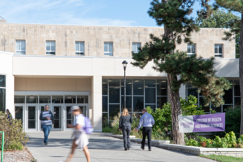 Students and faculty walking in the vicinity of the renamed College of Health and Human Sciences building. Sept 30, 2019. (Dylan Connell | Collegian Media Group)