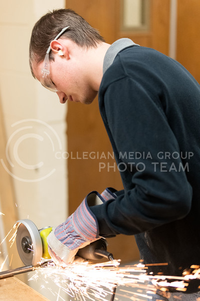 K-State, Sr majoring in Electrical Engineering, Eero Halbleib, member of the K-State Combat Robotics team, cuts spare shaft parts used to hold the weapons on their Bot. (Dylan Connell   Collegian Media Group)
