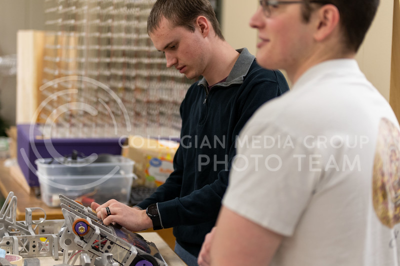K-State Combat Robotics team members, Eero Halbleib, and Kyle Bannon check the belts before testing the robot. This Robot will be prepared for battle once the armor and weapons are attached. (Dylan Connell | Collegian Media Group)
