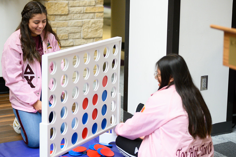 Tatiana Briceño, sophomore studying mathematics and Spanish at K-State and  Leslie Ramirez, senior at K-State studying Education-English and Spanish Translation play Connect Four during first-generation celebration in the student union. National First-generation College Student Celebration day is Friday, Nov. 8. The Union Program provided food, drinks, music, and games for all interested in celebrating the success of first-generation college students, faculty, and staff on K-State's campus. (Dylan Connell | Collegian Media Group)