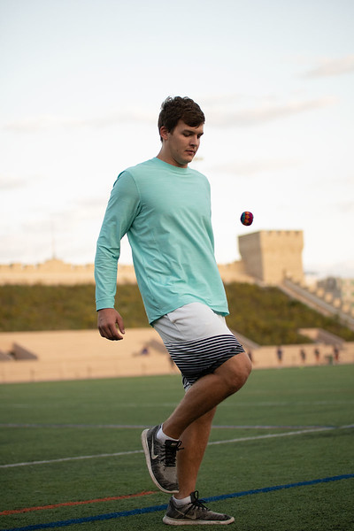 Patrick George, Sophomore studying Biomedical Engineering, knees the hacky sack while playing against his fellow hacky sack club members. Oct 3, 2018. (Dylan Connell | Collegian Media Group)