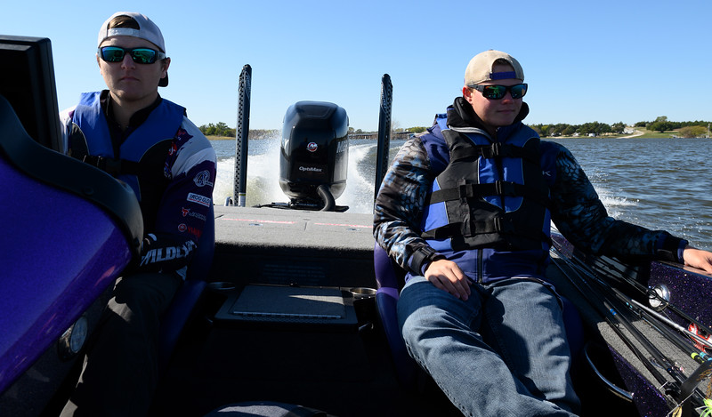 Zach Vielhauer and Michael Mueting changing fishing locations while practicing at Milford Lake. Preparing for the Big Bass Bash Fundraiser Tournament. Oct 12, 2019. (Dylan Connell | Collegian Media Group)