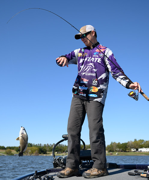 Zach Vielhauer, majoring in Construction Science, catches a crappie, while practicing for the Big Bass Bash Fundraiser Tournament located at Milford Lake. Oct 12, 2019. (Dylan Connell | Collegian Media Group)