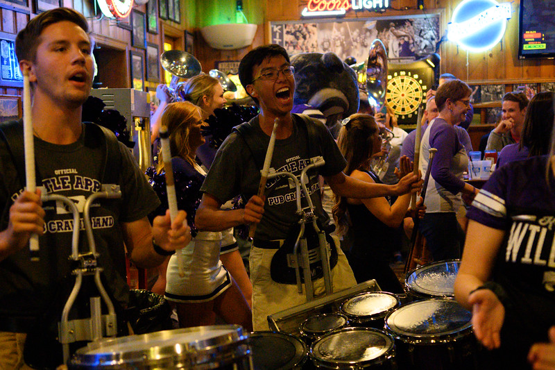 Kite's Bar and Grill was one of the restaurants that hosted the K-State marching band during the Pub Crawl. Drum line students play along to Wabash Cannonball. The K-State marching band took over Aggieville the night before K-State defeated TCU 24-17 on Oct 18, 2019. (Dylan Connell | Collegian Media Group)