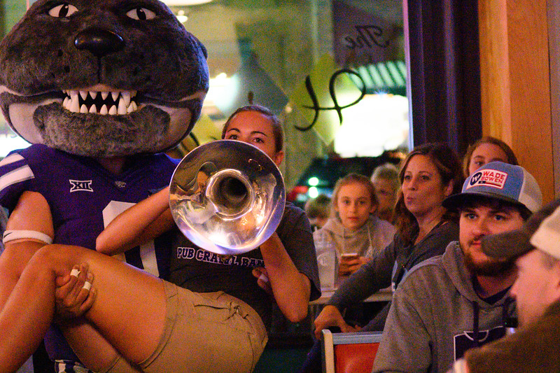 Willie Wildcat joins the marching band in their performance to The Hi Lo's unsuspecting guests. Willie pumped up the crowd with dances and photo ops, as well as interactions with the band. The K-State marching band took over Aggieville the night before K-State defeated TCU 24-17 on Oct 18, 2019. (Dylan Connell | Collegian Media Group)