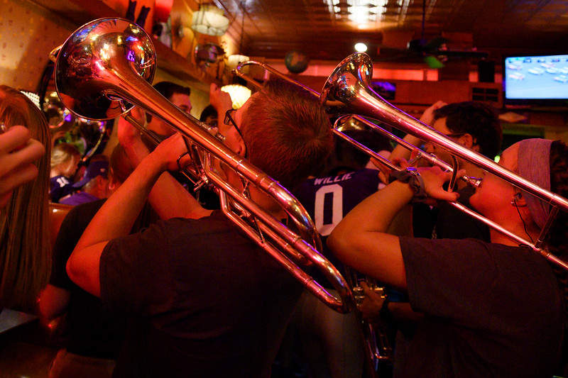 The K-State Marching Band storms Aggieville before every home game; this tradition is known as the Pub-crawl. While compacted in the restaurant's limited space, the trombone players, among other marching band students, serenade Rock-A-Belly Bar and Deli dining guests. The K-State marching band took over Aggieville the night before K-State defeated TCU 24-17 on Oct 18, 2019. (Dylan Connell | Collegian Media Group)